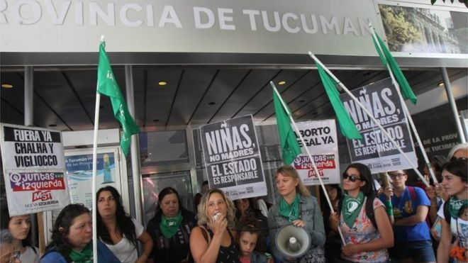 """Pro-choice activists protest outside the Tucumán Provincial Government building, holding signs that read """"Girls, not mothers. The state is responsible."""" Photo: EPA via  BBC News ."""