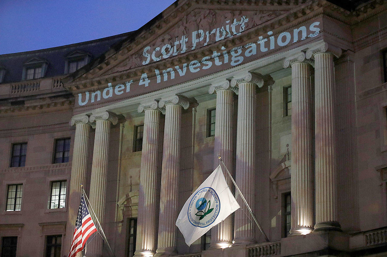 The Environmental Protection Agency's facade, projected with allegations about its (now former) head, Scott Pruitt. Photo: Alex Brandon/ AP