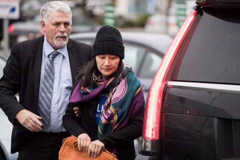 Meng Wanzhou leaving her home in Vancouver  Photo:  Darryl Dyck/Canadian Press