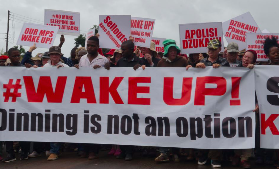 Protestors march in Lilongwe, the capital of Malawi, to protest the continued attacks against people with albinism. Photo: L. Masina/ VOANews