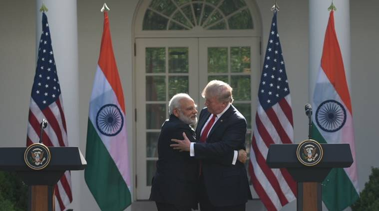US President Donald Trump and Indian Prime Minister Narendra Modi embrace in the Rose Garden during a joint press conference at the White House in Washington, DC, June 26, 2017. Photo:  The Indian Express