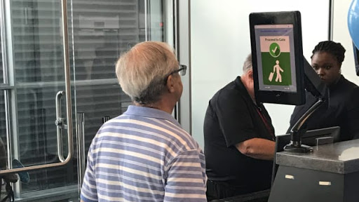 A photo of a man taking a facial recognition photo at the airport. Photo Credit: Gregory Wallace /CNN