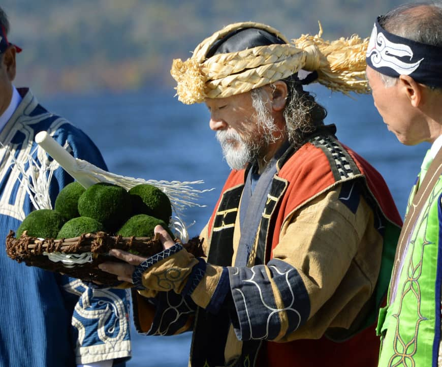 A man offers prayers during an Ainu ceremony thanking the blessings of nature at Lake Akan in Hokkaido, Japan's main northern island and homeland of the Ainu. Photo:  KYODO