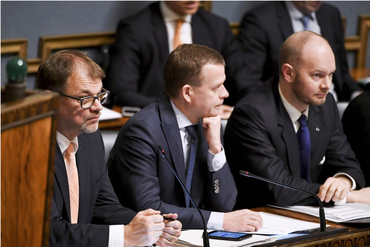 Prime Minister Sipilä (Kesk, left), Minister of Finance and Deputy Prime Minister Petteri Orpo (NCP, center), and Minister for European Affairs, Culture and Sports Sampo Terno (SIN, right) — leaders of the three parties in Sipilä's coalition government — at a session of the Finnish Parliament. Photo:  Vesa Moilanen/Lehtikuva