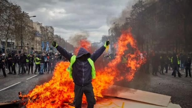 "Police have doubled-down efforts to contain ""Yellow Vest"" protests in Paris following increased violence and the vandalism of local businesses on March 16. Photo:  Time"