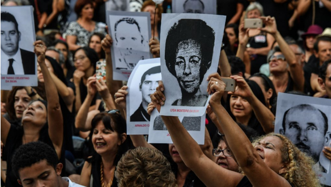 Protestors holding up photographs of individuals who went missing during the dictatorship as part of the demonstrations in Rio de Janeiro. Photo: Nelson Almeida/ AFP/  France 24