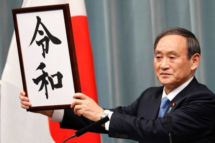 Chief Cabinet Secretary Yoshihide Suga holds up the characters of the new imperial era name, Reiwa, echoing then-Chief Cabinet Secretary Keizo Obuchi's  press conference  in 1989 that revealed the era name Heisei to the public upon the death of Emperor Showa. Photo:  AP/Eugene Hoshiko