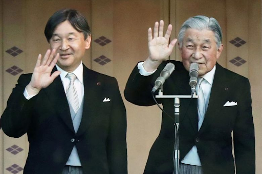 Crown Prince Naruhito (left) and his father Emperor Akihito (right) wave to the crowd at the Imperial Palace in Tokyo on Jan. 2, 2019, after the emperor delivered his final New Year's address. Photo:  AFP/Jiji Press