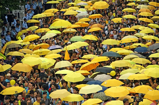 "Protestors gather outside Hong Kong's government headquarters on the first anniversary of the 2014 Hong Kong ""Umbrella protests."" Photo:  King Cheung/AP"