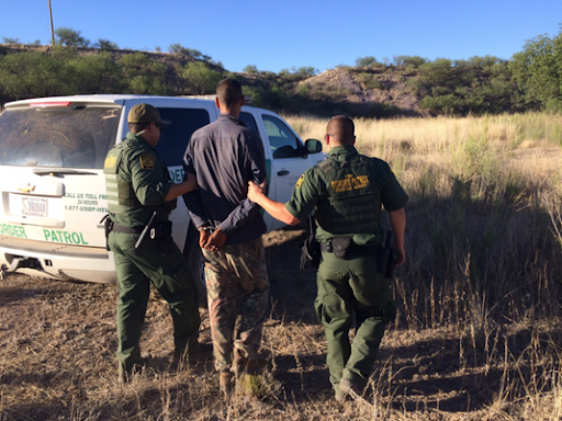 Arizona Border Patrol Arresting an Illegal Immigrant  Photo:  Arizona Customs and Border Protection
