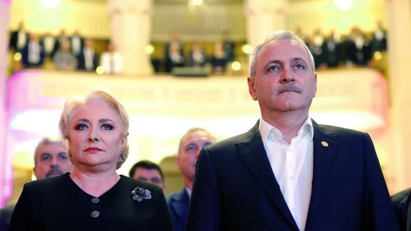 Romanian Prime Minister Viorica Dăncilă (left) and President of the Chamber of Deputies (and PSD President) Liviu Nicolae (right) rise during the playing of the Romanian national anthem during the opening of the PSD National Council at the Palace of the Parliament in Bucharest, Romania, on Dec. 16, 2018. Photo:  Robert Ghement/EPA/EFE