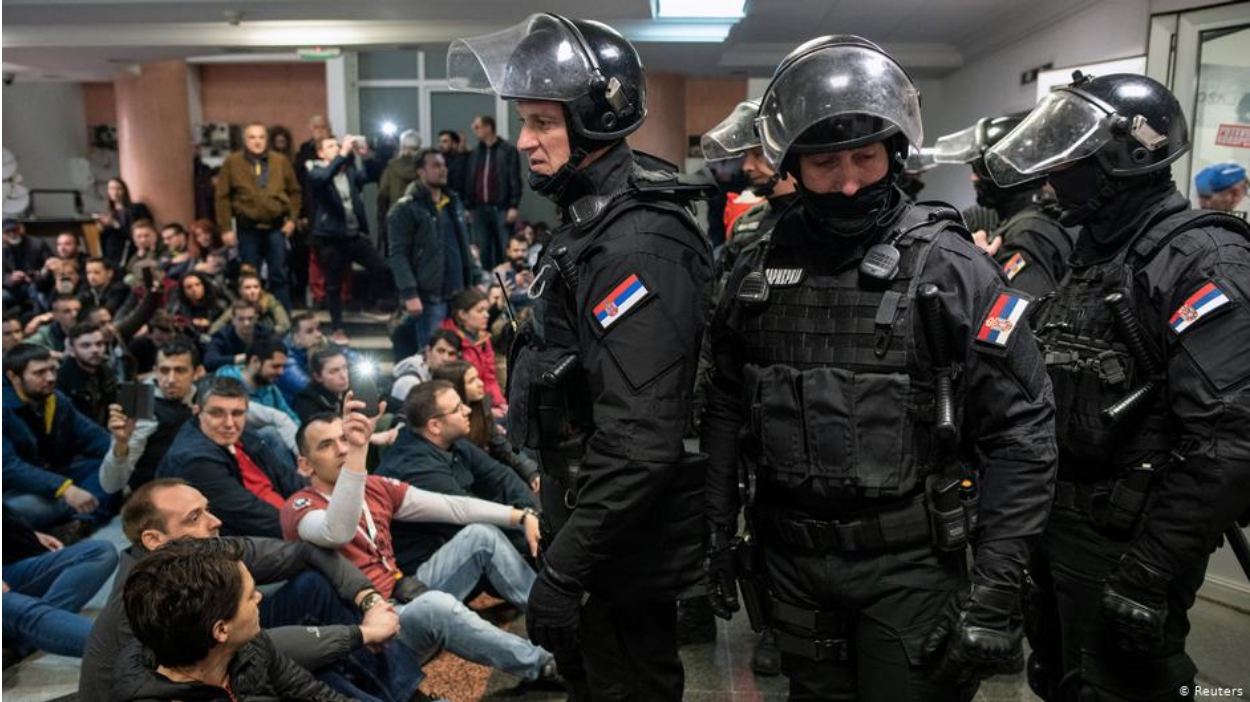 Anti-government protesters occupying the Serbian state-run RTS television station building are confronted by riot police before being ejected on Mar. 16, 2019. Photo:  Reuters