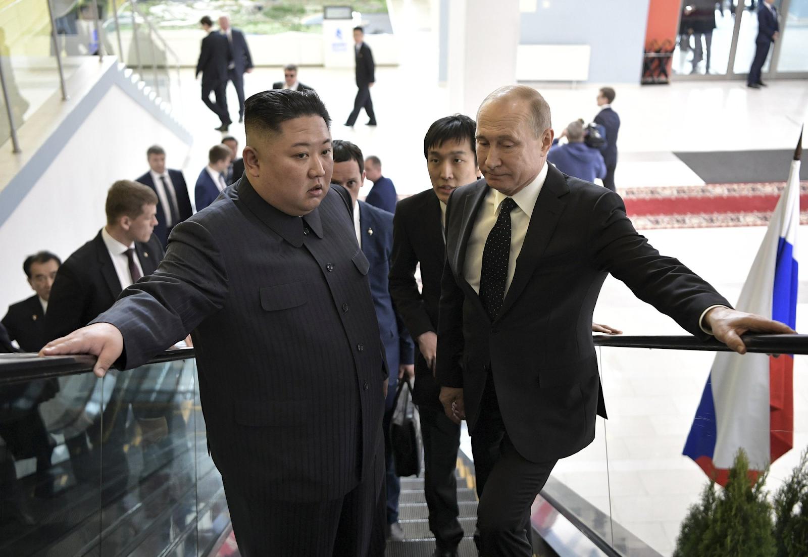 North Korean Supreme Leader Kim Jong-un (left) and Russian President Vladimir Putin (right) take an escalator to the room for their talks in Vladivostok, Russia, on April 25, 2019. Photo:  Alexei Nokolsky/Sputnik, Kremlin Photo Pool via AP