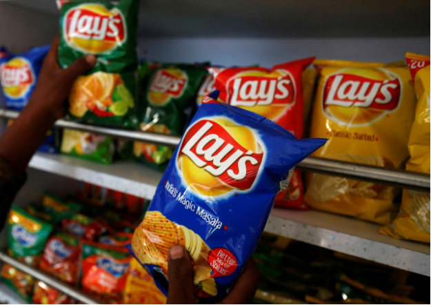 Pepsico's lawsuit concerns the FC5 variety of potatoes used to produce its subsidiary, Frito-Lay's potato chips. (In the picture) A customer picks a packet of Lay's potato chips at a convenience store in Ahmedabad on Friday, April 26. Source:  Reuters