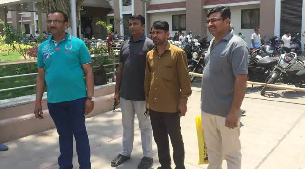 The four accused farmers (from left to right) Hari Patel, Bipin Patel, Chhabil Patel, and Vinod Patel at the Ahmedabad district court for the April 26 hearing. Source:  The Indian Express
