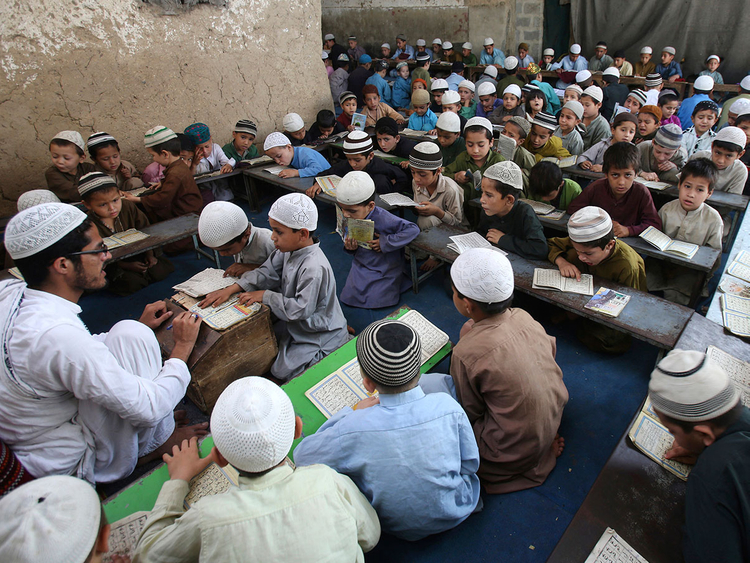 Students at a religious institution in Karachi, Pakistan; Photo:  Gulf News/AP