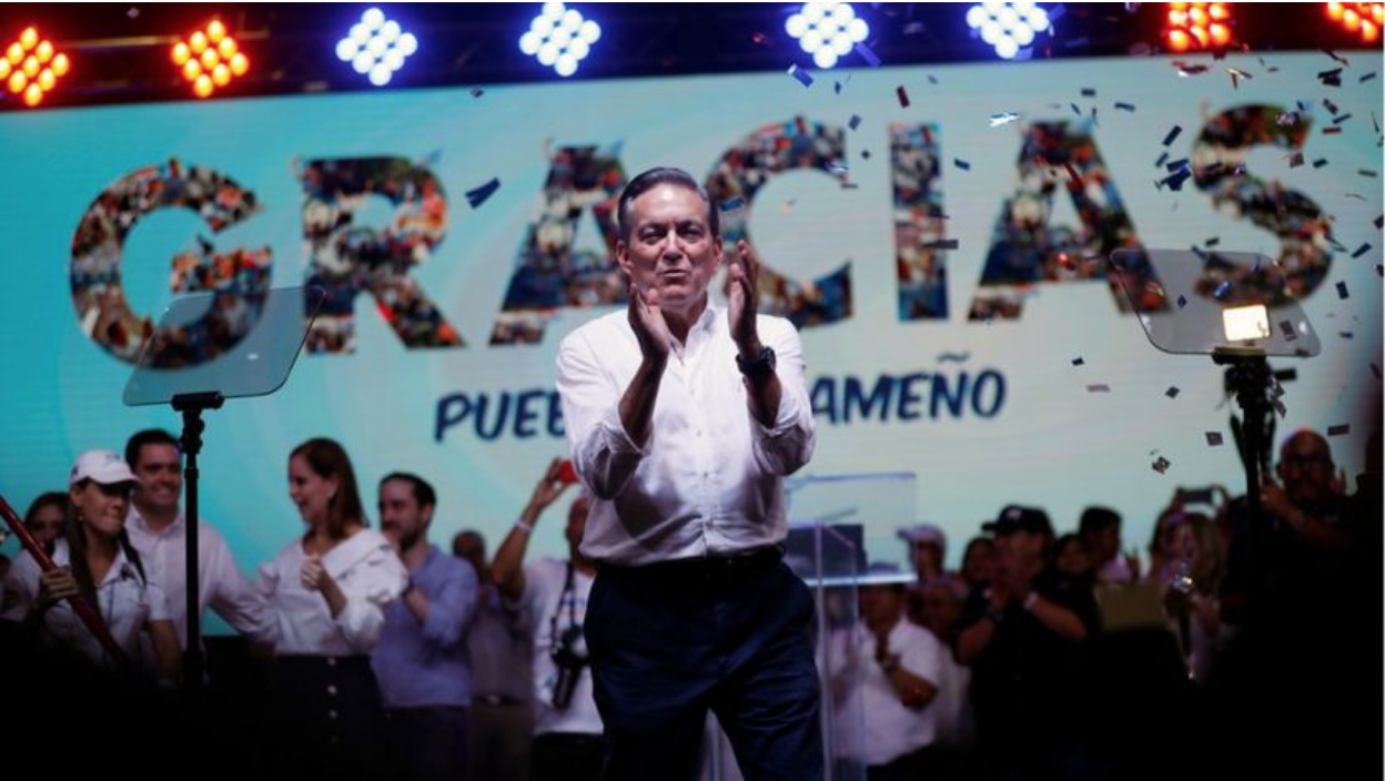 """President-elect Cortizo is photographed in front of a large panel that reads: """"Thank you, People of Panama"""". Photo: Reuters/ BBC"""