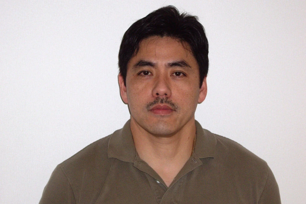 Jerry Chun Shing Lee, former CIA agent, may face up to life in prison but prosecutors will seek a range of 17 to 27 years for his guilty plea. Photo:   The New York Times