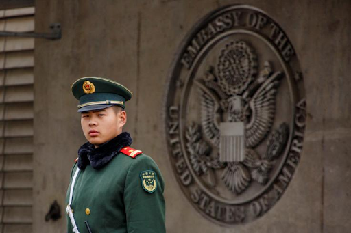 A Chinese paramilitary People's Armed Police officer guards the entrance to the US embassy in Beijing on April 5, 2018. Photo:  Reuters
