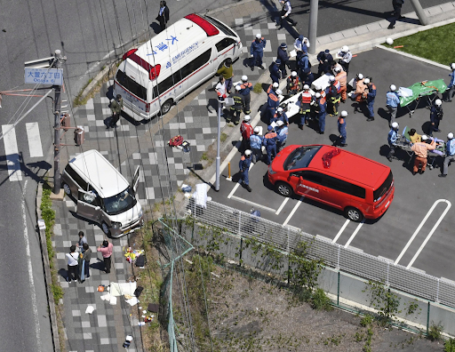 First responders tend to the wounded at the scene of the incident in Otsu, Shiga Prefecture, on Wednesday, May 8, 2019. Photo:  KYODO