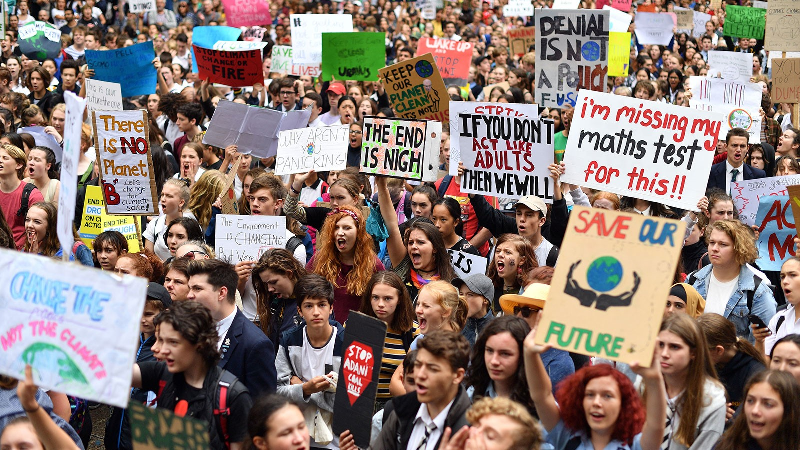 Youth protesters yell and hold signs at New York City's Climate Strike.  Photo: Saeed Khan/ Grist