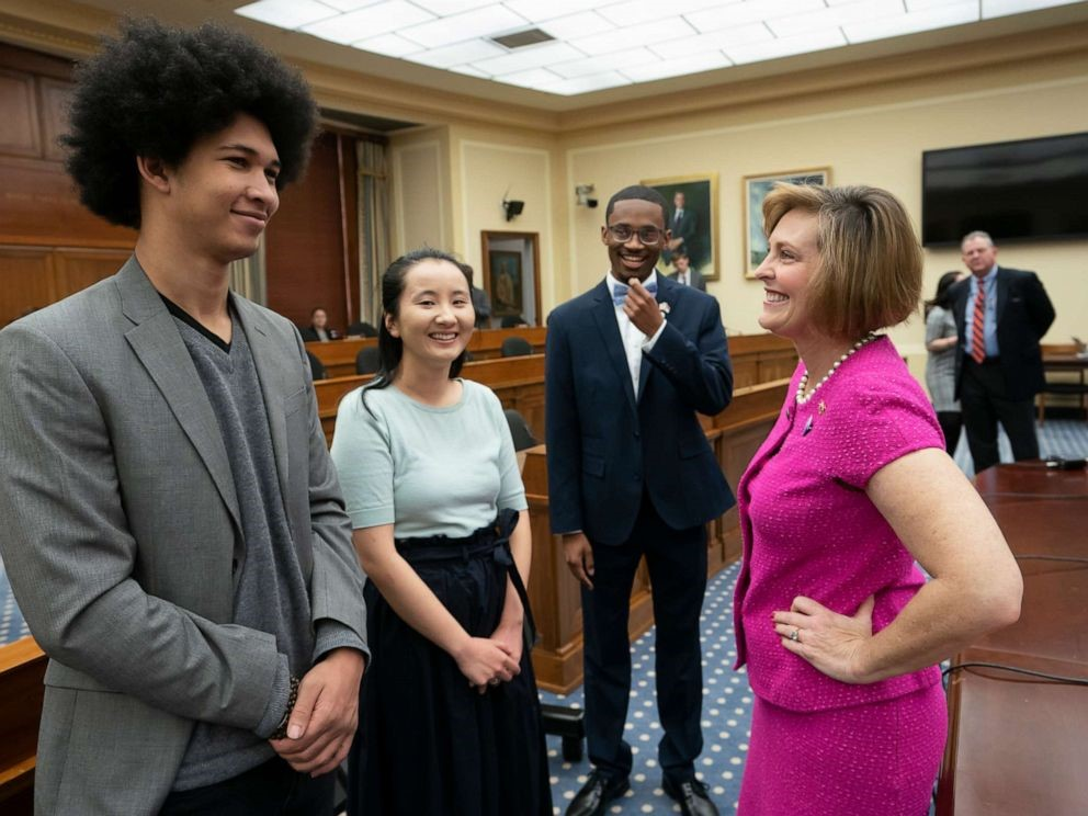 Florida Democratic Representative Kathy Castor talking with youth climate activists the day of the Climate Crisis Hearing.  Photo J. Scott Applewhite/ ABC News