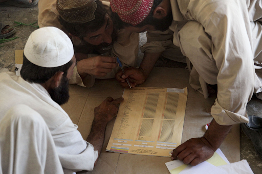 Afghanistan election workers count and organize ballots at a local school in the Nawa District. Photo: Sgt. William Greeson /  Wikimedia Commons