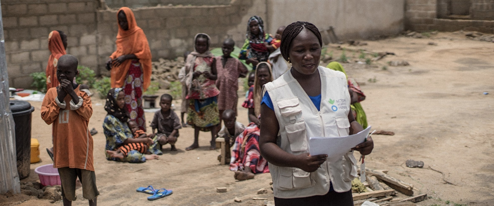 An Action Against Hunger volunteer works with malnourished children in Nigeria. Photo: Guy Calaf /  Action Against Hunger