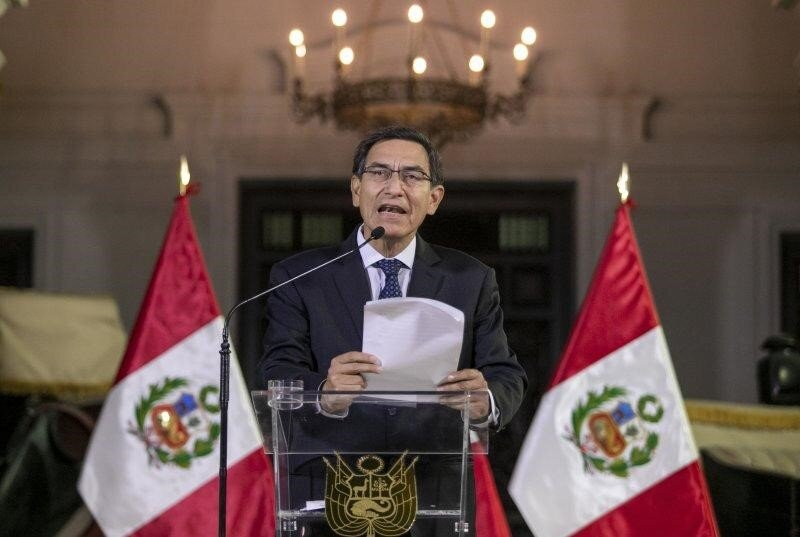 President Martín Vizcarra delivers a national message from the Presidential palace. Photo: AP/ Andrés Valle