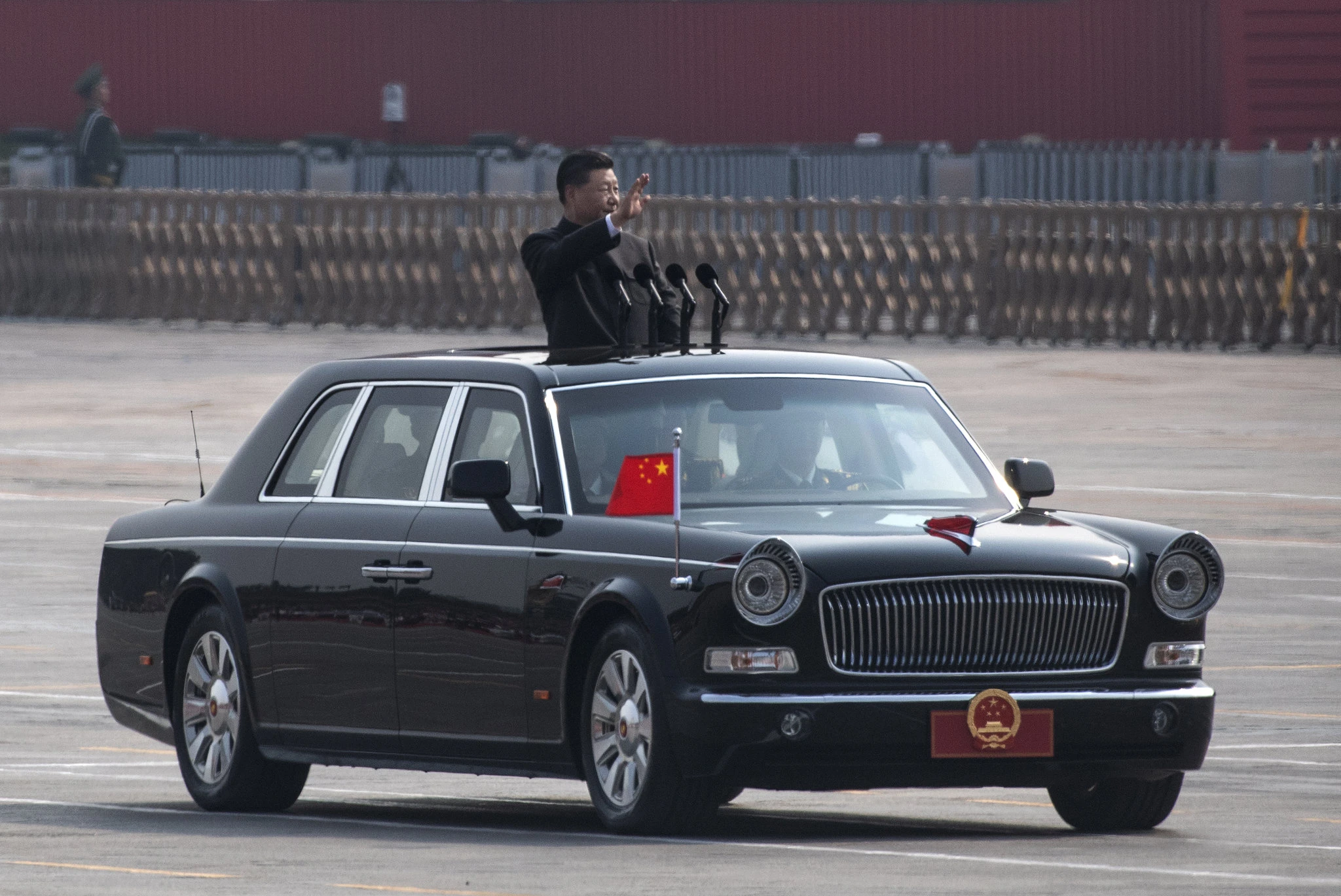 President Xi Jinping arrives at Tiananmen in a limousine to view the parade. Photo: Kevin Frayer /  Getty Images