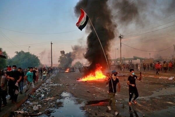 Violent demonstrations have sparked across Iraq, including this one in Central Baghdad.  Credit: Hadi Mizban, Associated Press