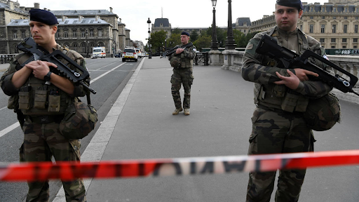 Three French sentries stand guard and monitor the nearby area surrounding the police headquarters following a deadly knife attack. Photo: Bertrand Guay /  AFP