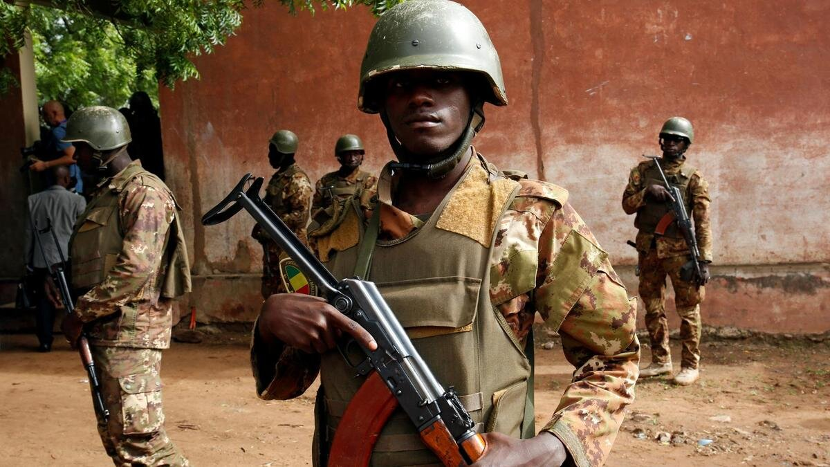 Troops of the Malian Armed Forces stand guard near Boulikessi military base in central Mali. Photo: Reuters /  The National