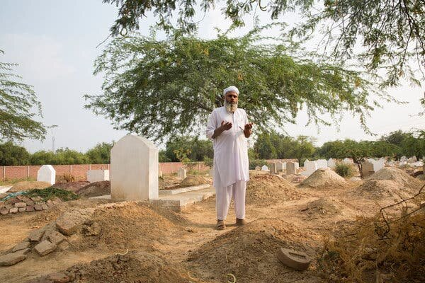 Qari Muhammad Ramzan, father of 8-year-old Muhammad Faizan who was raped and killed, recites a prayer at his son's grave in Chunian, Pakistan.  Photo: Saiyna Bashir/ The New York Times