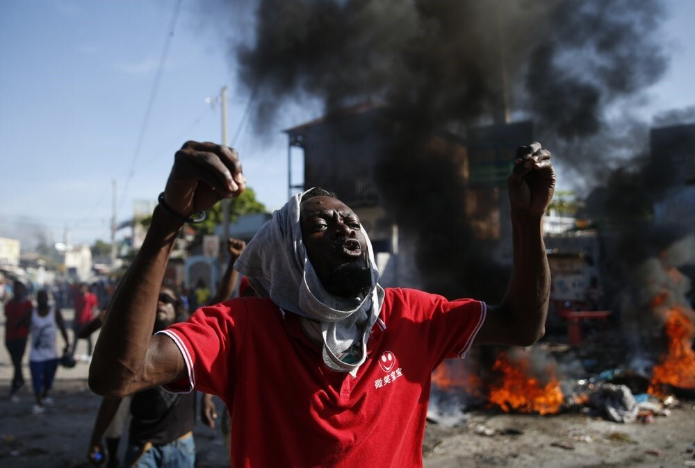 An anti-government protester shouts that President Moïse must step down. Photo: Rebecca Blackwell /  AP Photo
