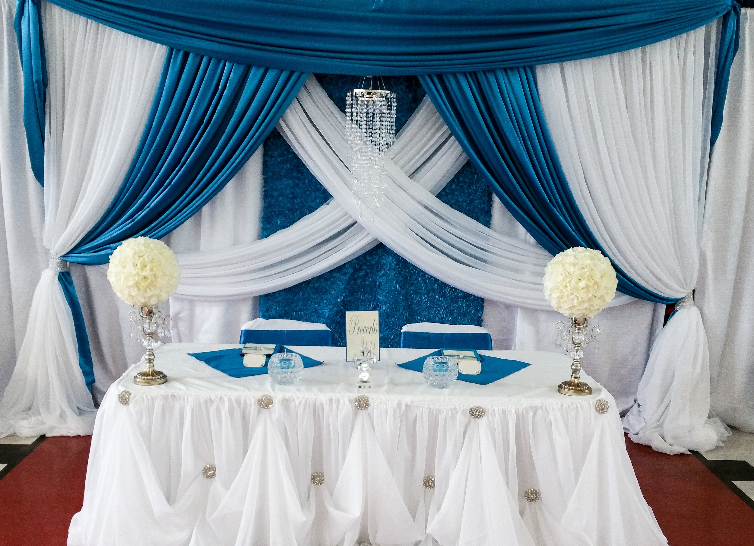 TMG (WEDDING COUPLE SETTING TABLE) | PHOTO BY ANDRE ALRIDGE