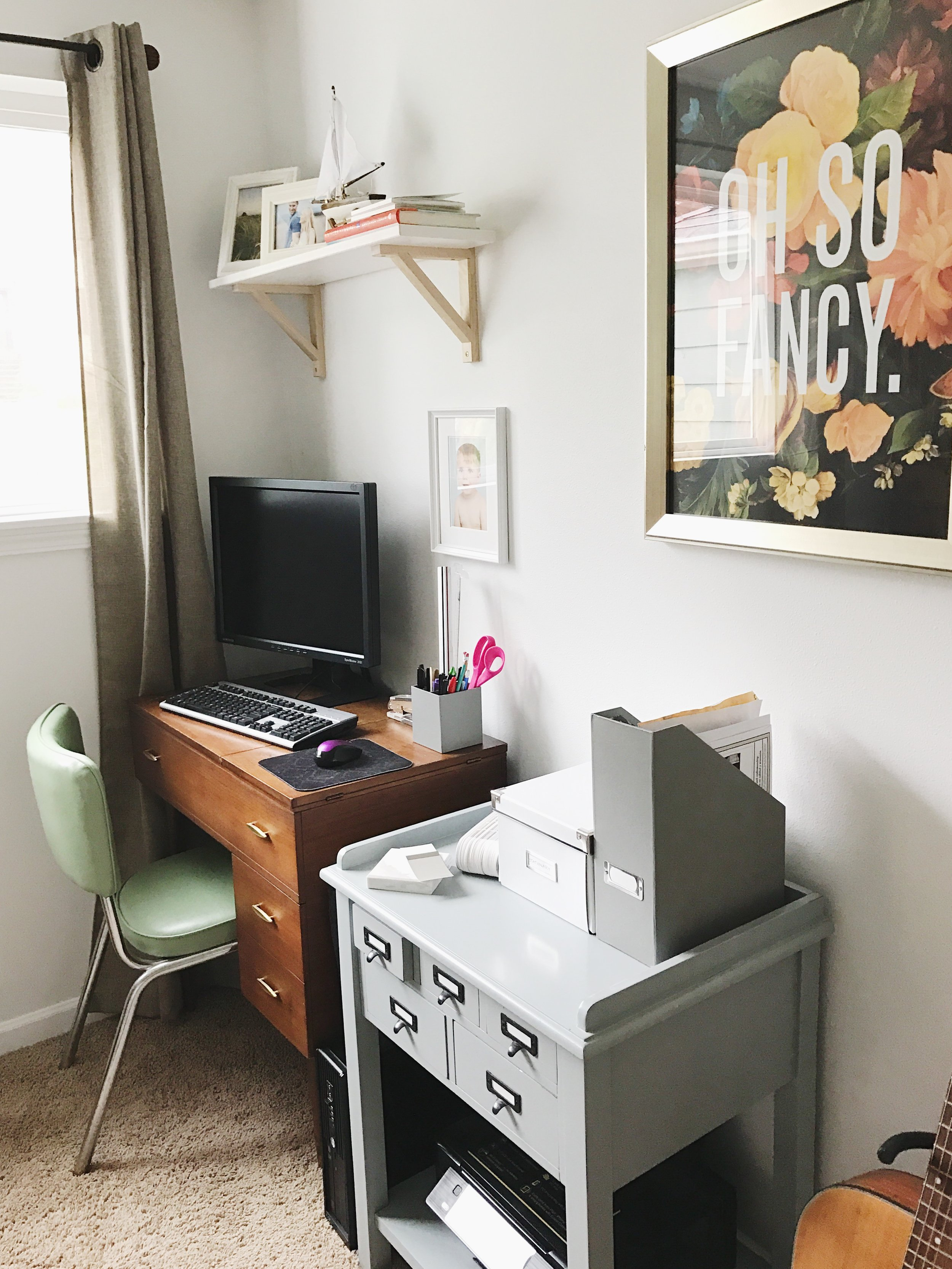 The sewing table is intended to be used as a laptop desk but temporarily for now my old monster drafting desktop has to reside here.