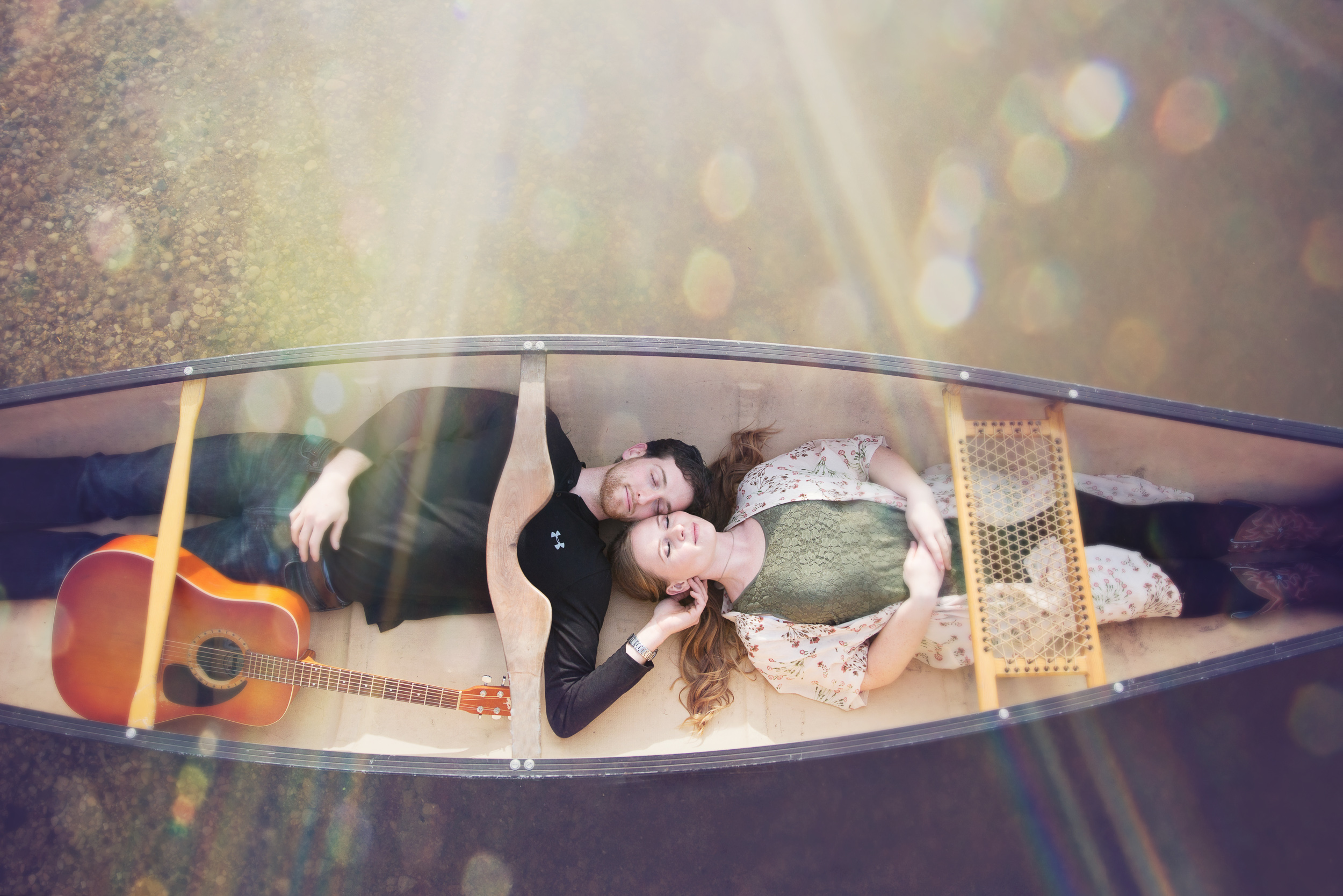 I love these guys, and I love that they hauled a canoe to their engagement photo shoot!
