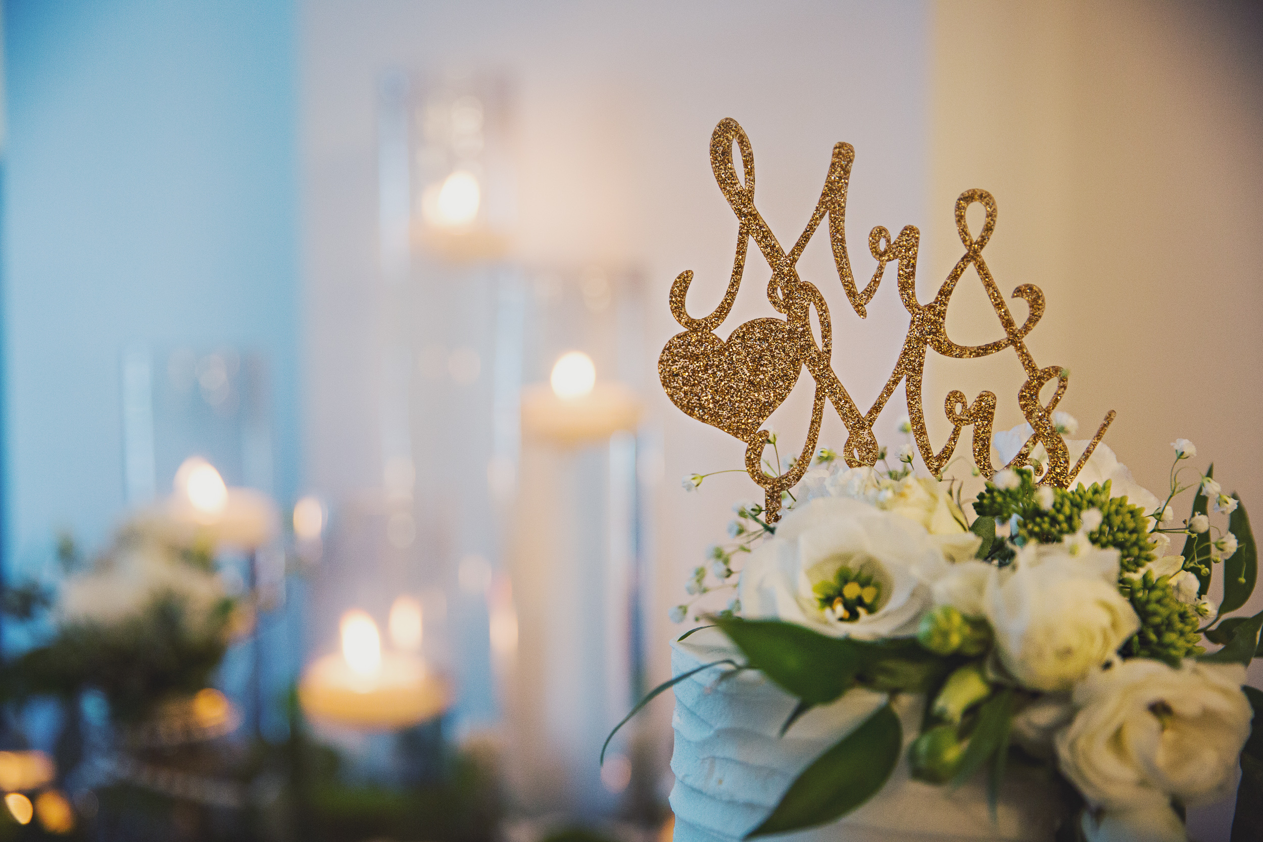 I loved their cute Mr & Mrs cake topper, and the pillars of floating candles all throughout the reception!