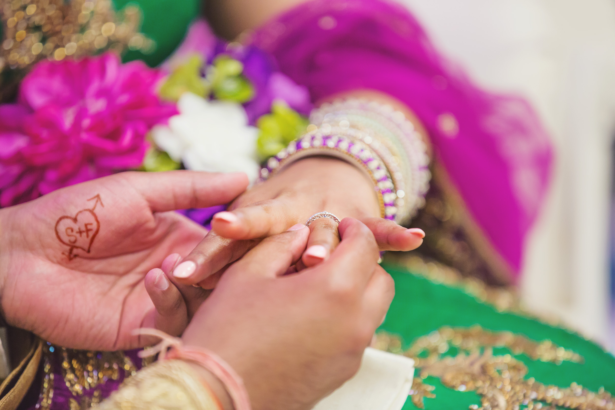 """Let's all just take a second to absorb how adorable it is that Feroze had """"S+F"""" done in henna on his hand, in a heart? This moment when he slipped the ring on Serina's finger stole my heart..."""