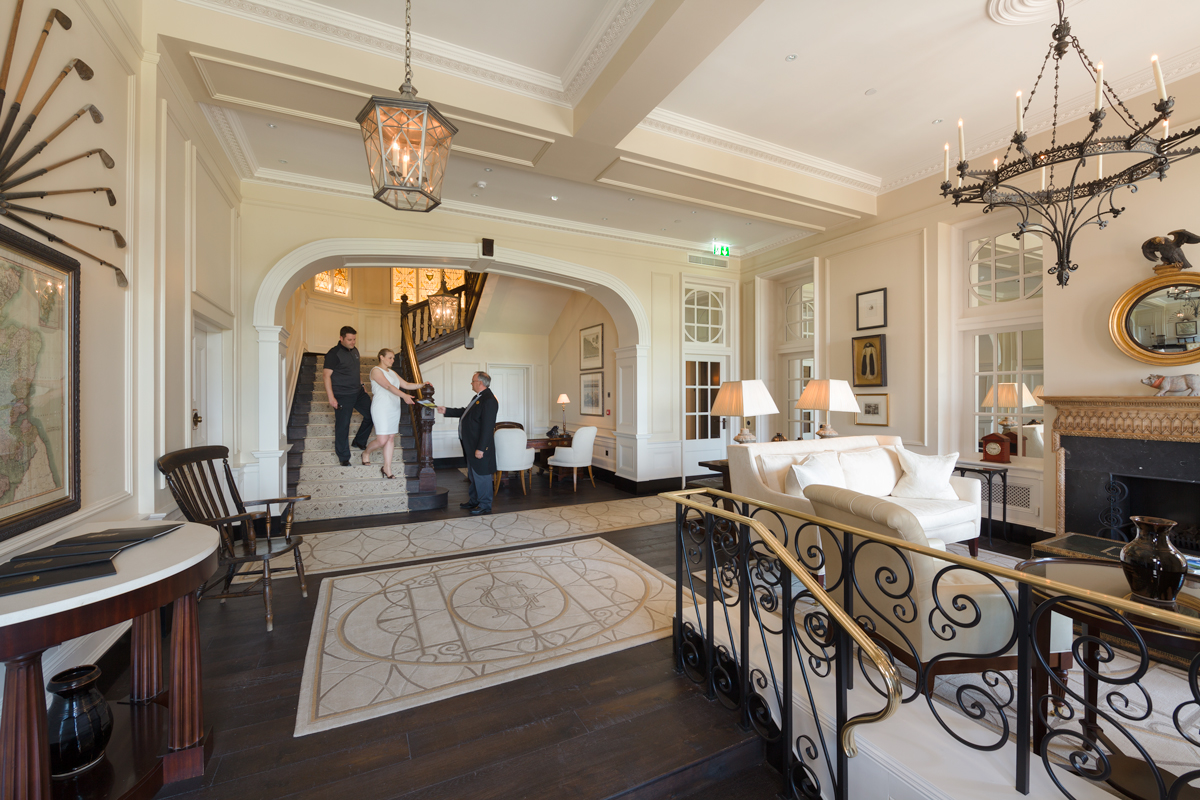Butler-greets-Couple-in-Foyer.jpg