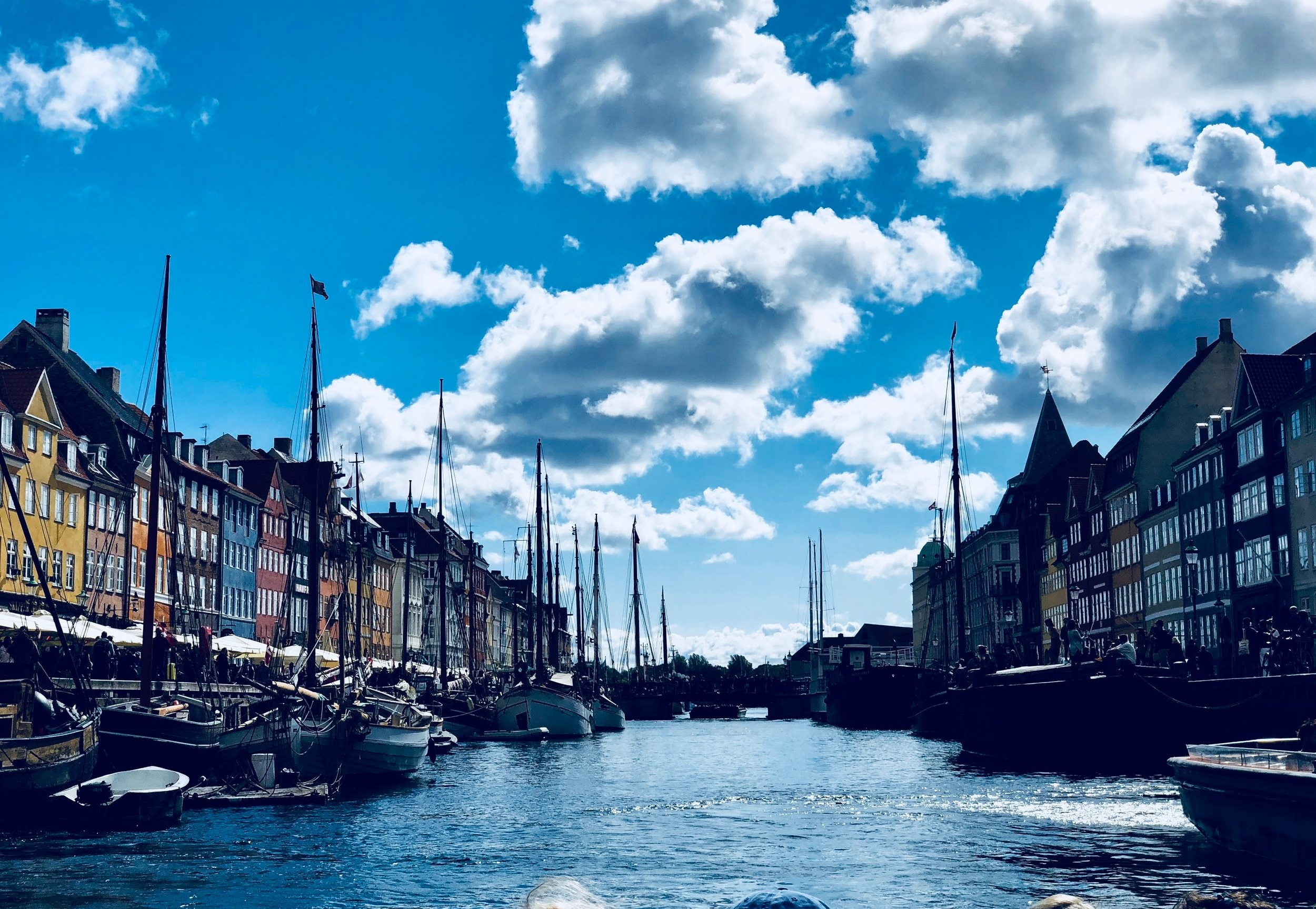 Nyhavn, Copenhagen - Nyhavn, built from 1670 to 1673, was commissioned by King Christian V and used as an international shipping port. Today, this picturesque spot is as popular with the locals as it is with tourists. Come, grab a beer, and enjoy the sunset!Photo by Miriam Bourin/Global Local Traveler