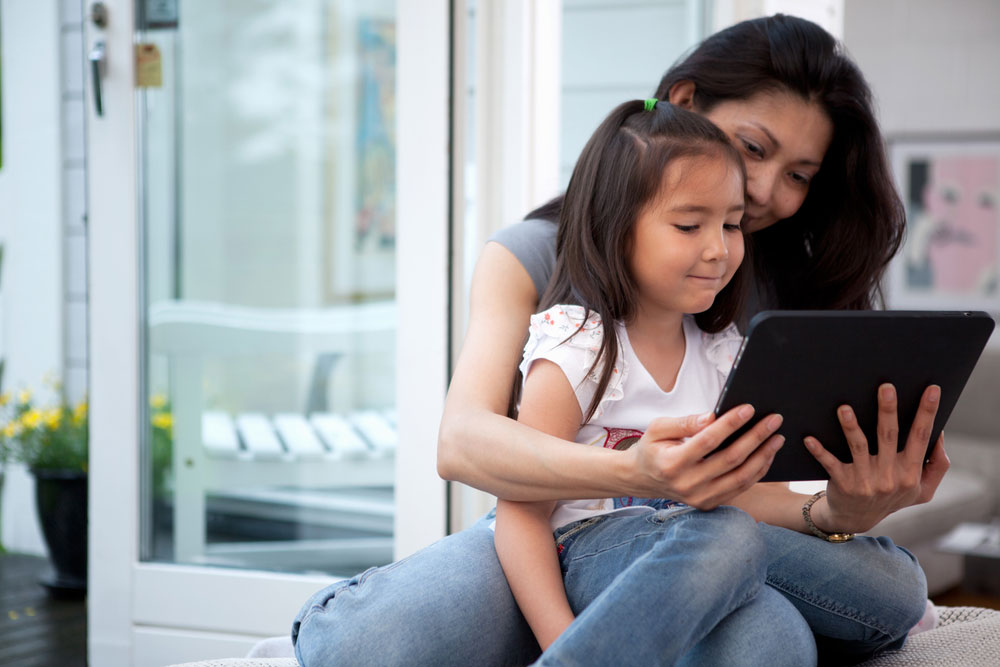 mom-and-child-working-on-an-ipad.jpg