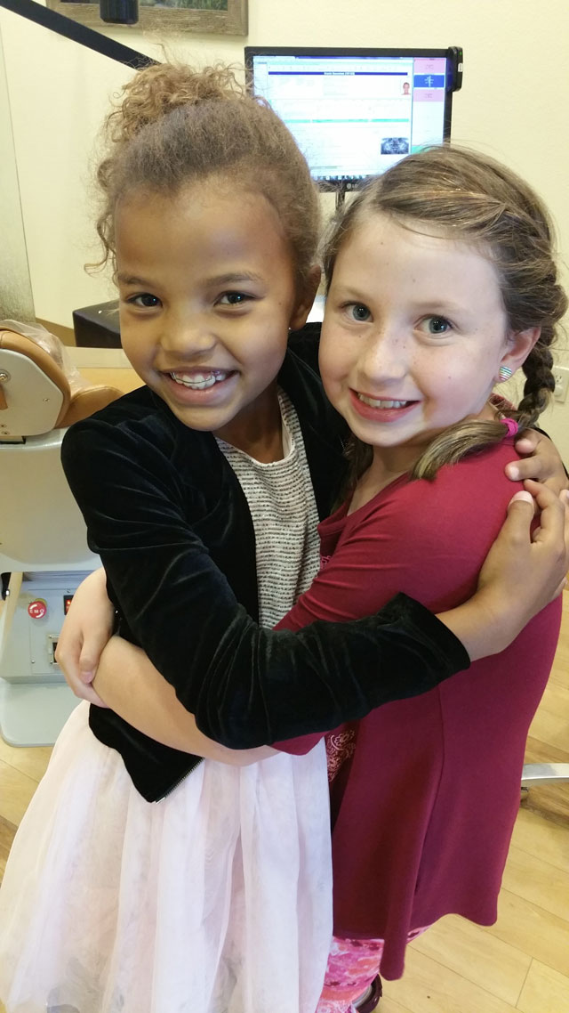 two-little-girls-with-early-treatment-hugging.jpg