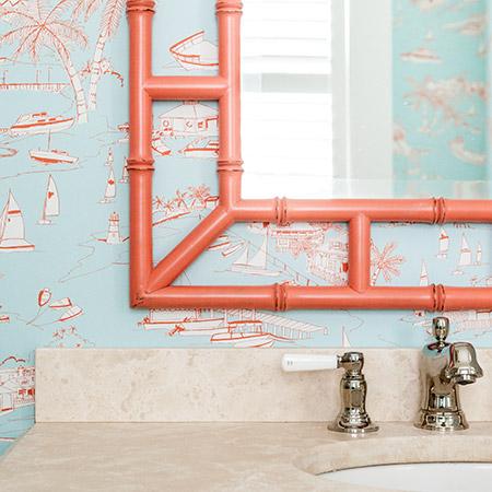 Hurlbutt Designs Kennebunk Meets South Beach home photo featuring a vibrant coral mirror and coastal wall coverings.