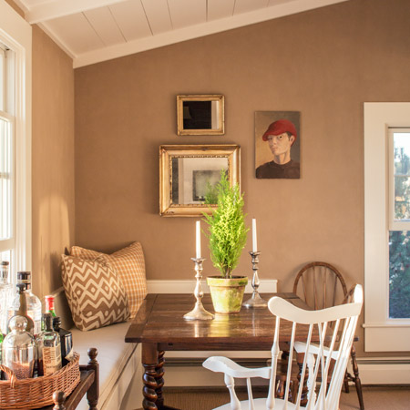 Hurlbutt Designs Kennebunk River Cottage Renovation featuring a redesigned dining room with beautiful artwork.