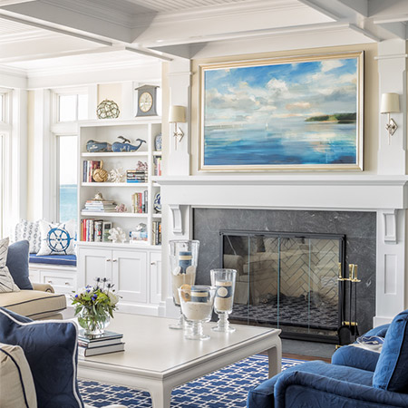 Hurlbutt Designs Scarborough Family Oceanside Home interior design project photo featuring a beautiful blue and white living room with gorgeous built-in's