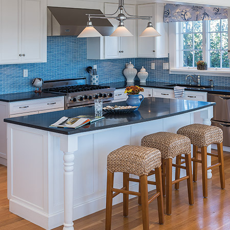 Hurlbutt Designs Goose Rocks Oceanfront Home photo featuring a newly renovated kitchen with beautiful blue and white accents.