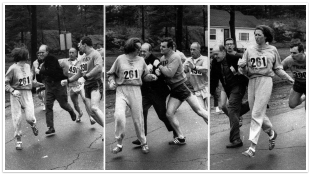A woman, listed only as K. Switzer of Syracuse, found herself about to be thrown out of the normally all-male Boston Marathon when a husky companion, Thomas Miller of Syracuse, threw a block that tossed a race official out of the running instead, April 19, 1967 in Hopkinton, Mass.  (AP PHOTO)