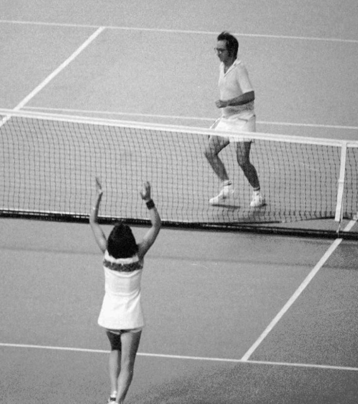 Billie Jean King raises her arms after defeating Bobby Riggs, in the 'Battle of the Sexes' at the Houston Astrodome in 1973.